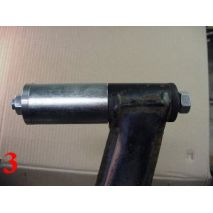 Install tool as shown. Simply continue to tighten the tool on the sleeve side until the bushing is off the trailing arm, and inside the tool sleeve.  Remove the tool, and take old bushing from sleeve.